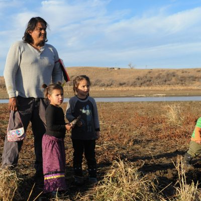 A family from the Cheyenne River tribe plays together near Turtle Island during a protest against plans to pass the Dakota Access pipeline near the Standing Rock Indian Reservation, near Cannon Ball, North Dakota, U.S. November 26, 2016. REUTERS/Stephanie Keith - RC11F6A7B3D0
